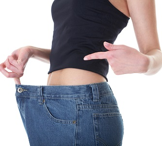 Woman Taking Garcinia With Big Size Jeans