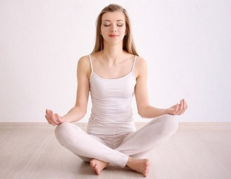 Photo of Meditating Woman
