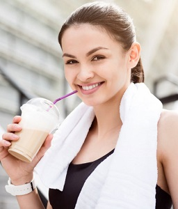Woman Drinking Coffee After Workout