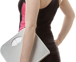 Fit Woman With Weighing Scale