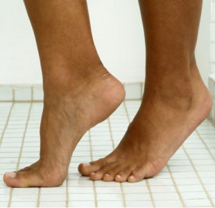 Feet in the Shower Room