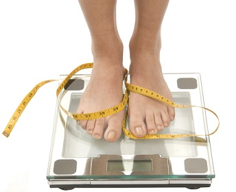 Woman Feet on Weighing Scale