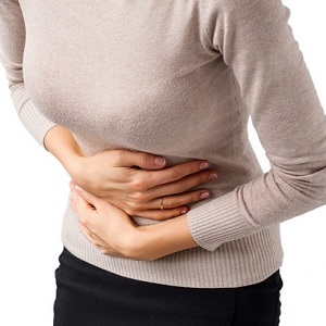 Woman having stomach pain