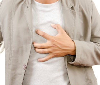 Man Pressing Chest Because of Heartburn Pain