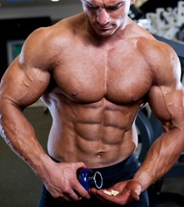 Bodybuilder with Bottle of Supplements