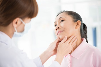 Doctor Examining Patient Thyroid