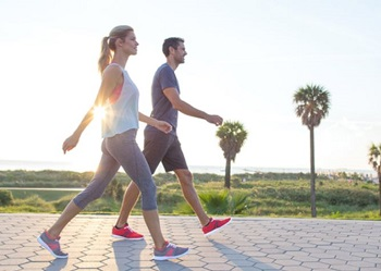 Healthy Couple Walking Outdoors